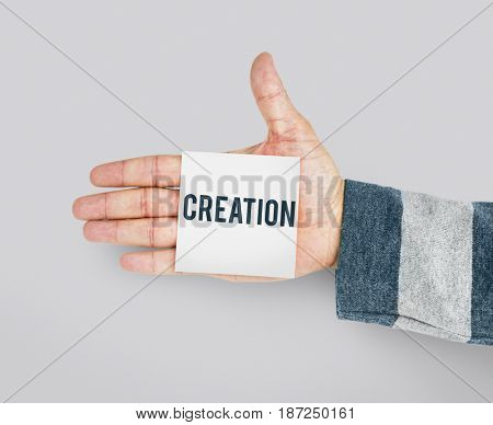 Hand with Sticky Note Showing Creative Ideas Design Word
