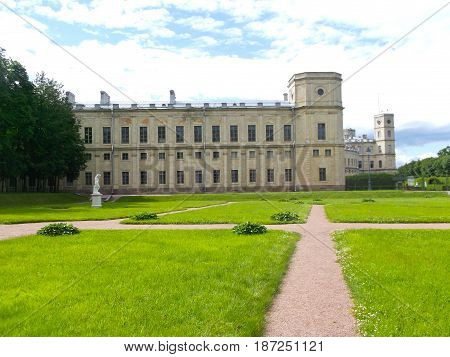 green lawn in front of the Big Gatchina Palace on a background of blue sky