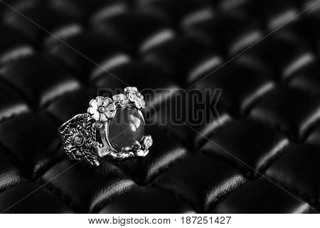Beautiful Ring On Black Leather Material