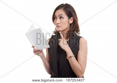 Young Asian Woman With A Book Is Thinking.