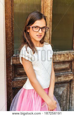 Preteen girl with teeth braces wearing beautiful dress and eyeglasses