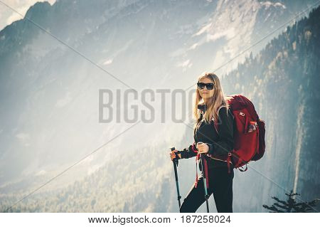Woman Traveler standing at mountains with backpack admiring landscape Travel Lifestyle concept adventure summer vacations outdoor