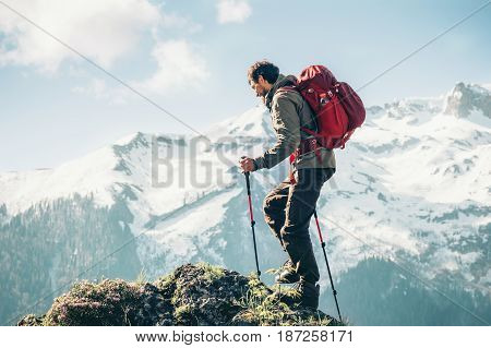Traveler Man climbing with backpack Travel Lifestyle concept active adventure summer vacations hiking outdoor mountains landscape on background