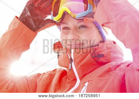Young woman wearing ski goggles outdoors