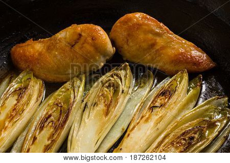 Fried Chicken And Chicory In Sauce