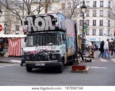 Graffitti On A Truck In A Market In Paris