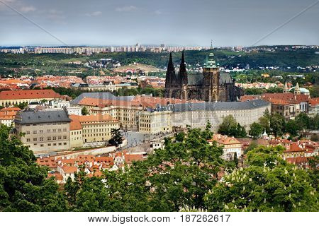 view to Hradcany with Prague castle and St. Vitus Cathedral from Petrinska rozhledna tower in sping Prague in Czech republic