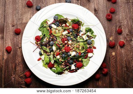 Green Salad With Arugula And Berries And Goji, Chia