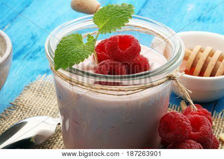 Beautiful Appetizer Pink Raspberries Fruit Smoothie Or Milk Shake In Glass Jar With Berries Backgrou