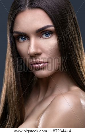 Portrait of beautiful woman with glistening hair in studio