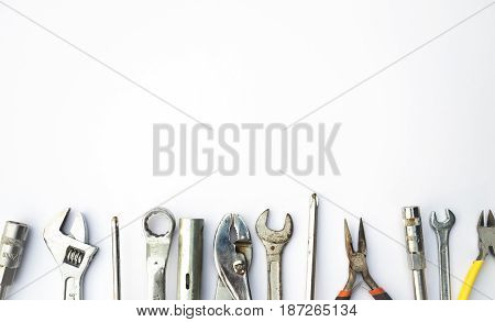 Dirty tools and equipments such as screw driver wrench plier on white background
