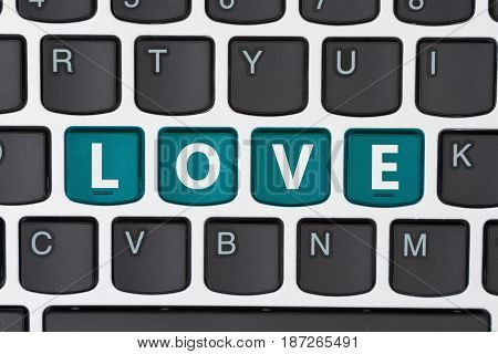 Searching for love online A close-up of a keyboard with teal highlighted text Love 3D Illustration