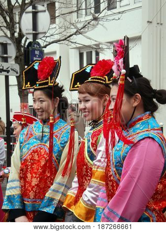 Chinese new year parade in Paris, february 2011 6th (Portrait of 3 women in traditional costume)