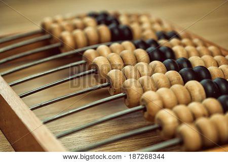 Vintage wooden abacus on the table. Vintage bills