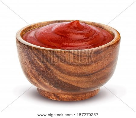 Ketchup in wooden bowl isolated on white background. Portion of red tomato sauce. With clipping path.