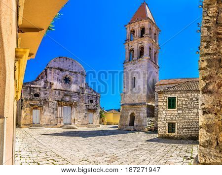 Old architecture in city center of town Starigrad, Island Hvar square view, european summertime travel places.
