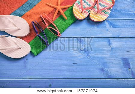 Summer Vacation Concept On Blue Wooden Background - Top View