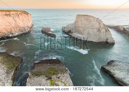 Sunset over Shark Fin Cove (Shark Tooth Beach). Davenport, California, USA.