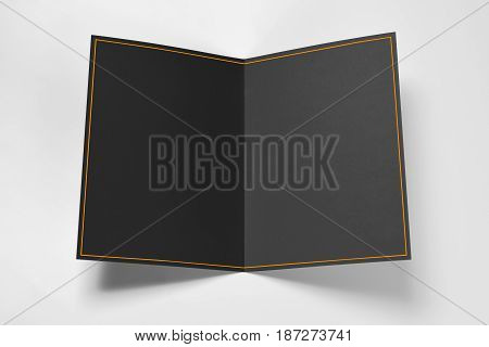Blank black card with yellow frame over grey background