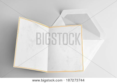 Blank open card with yellow frame and envelope