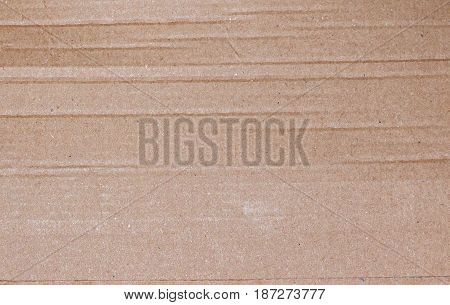Cardboard texture with dents. Carton paper background