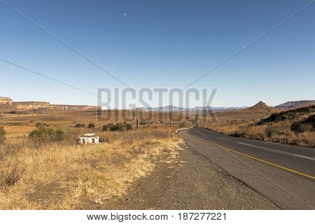 Empty Rural Asphalt Road Running Through Dry Winter Landscape