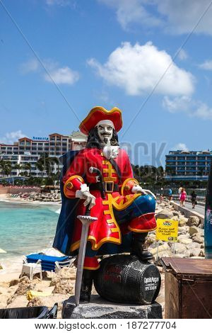MAHO BAY BEACH  AUGUST 01: Captain Morgan statue near Sunset Bar and Gril at Maho Bye Beach near Princess Juliana International Airport, seen in Maho Bye Beach , St.Marten on August 1, 2015