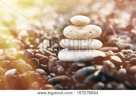 Stones pyramid on the beach. Zen and harmony concept.