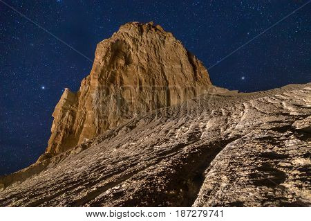Rocks and cliffs in the desert canyon of Boszhira on background of the starry sky, chines of Ustyurt, Kazakhstan