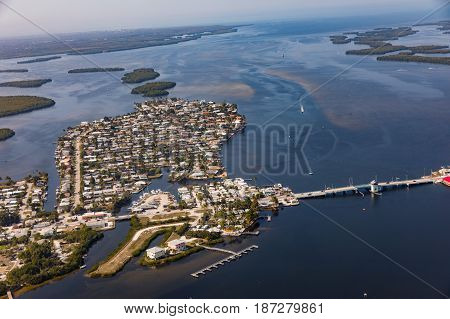 An aerial view of the historic Florida town Matlacha and bridge connecting by bridge with Pine Island with Cape Coral. Florida