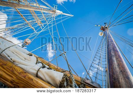 Folded sail and mast on an old sailboat
