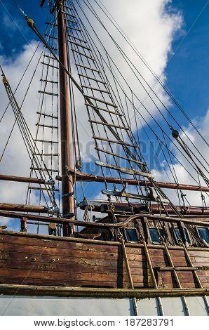 Old collapsing sailboats at the dock close-up