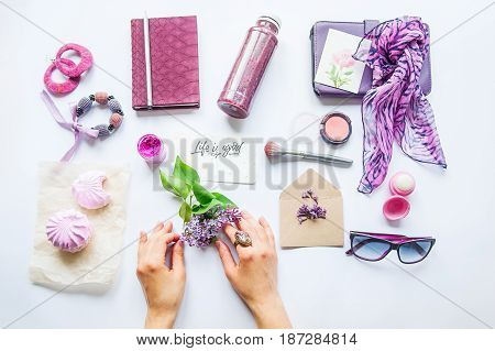 Beauty Blog Concept. Lilac Colour. Female Hands Keep Lilac Flower Among Styled Accessories: Sunglass