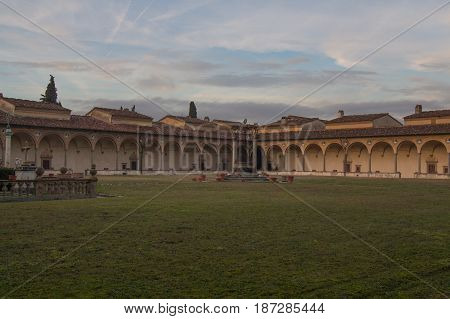 Italy Florence - December 24 2016: the view of the large cloister and inner courtyard of Florence Charterhouse church Certosa di Galluzzo di Firenze on December 24 2016 in Florence Tuscany Italy.