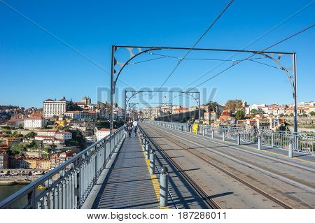 PORTO PORTUGAL - OCTOBER 20 2015: The Dom Luis I Bridge is a double-decked metal arch bridge that spans the Douro River between the cities of Porto and Vila Nova de Gaia in Portugal