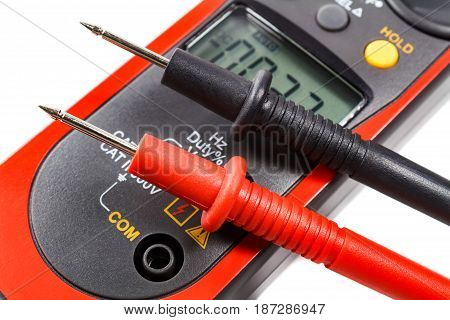 Digital Clamp Multimeter With Probes On A White Background