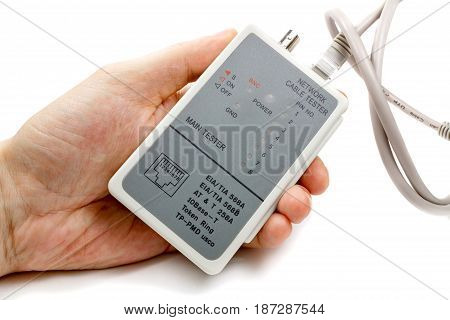 Network Cable Tester In Man's Hand And Utp Cable On A White Background