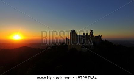 Sunset over Pena Palace castle in São Pedro de Penaferrim, in the municipality of Sintra, Portugal.