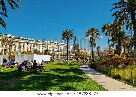 People Walking And Relaxing In Albert I Gardens