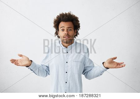 Clueless Mixed Race Guy Shrugging His Shoulders As If Saying So What, Who Cares After He Let Down Hi