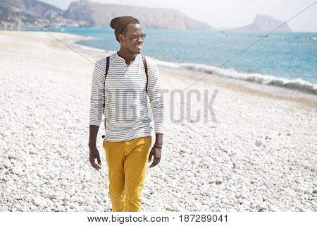 Happy Young Afro American Male Tourist Dressed Stylishly Smiling Broadly Enjoying Seascape And Sunny