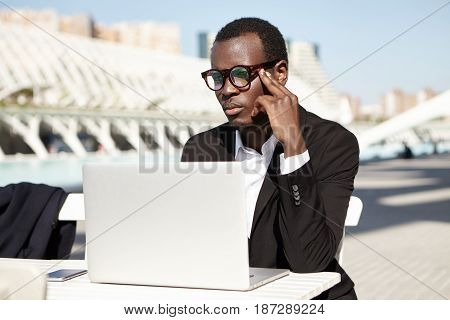 People, Lifestyle, Business, Technology Concept. Successful Attractive Dark-skinned Man In Black Sui