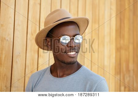 Happy Positive Young Dark-skinned Bearded Male Model With Broad Cheerful Smile Wearing Trendy Clothi