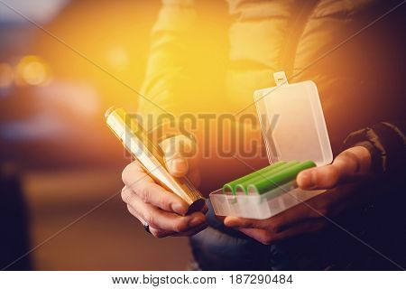 Electronic cigarette for vape with a battery in a club of smoke. Concept of giving up tobacco. Steam. high contrast and monochrome color tone.