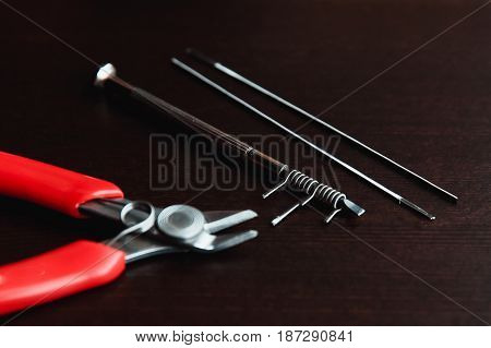 Repair, maintenance of the vaping device mod. Pliers, wire, fichral, coil, screwdriver
