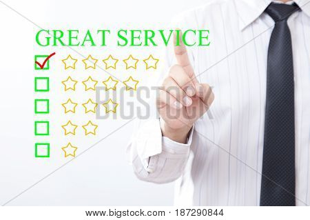 Businessman click concept GREAT SERVICE message Five golden stars.