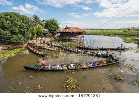 INLE LAKE, MYANMAR - OCTOBER 06 2014: Tourist travel in Inle lake the largest freshwater lake in Myanmar.