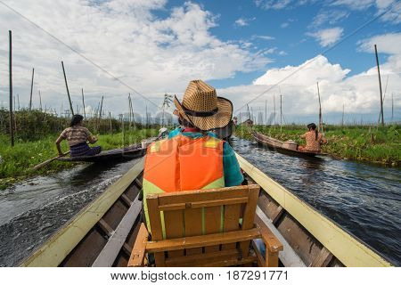INLE LAKE, MYANMAR - OCTOBER 06 2014: Tourist travel in Inle Lake by boat, Inle Lake is the largest freshwater lake in Shan state of Myanmar.
