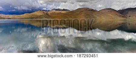 Summer Thunderstorm On The High Mountains Of Lake Tso Moriri: Gloomy Gray And Black Clouds And Mirro