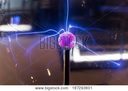 Big Glass Purple Plasma Globe Inside Of A Building